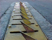 Install road spikes in Baytown, TX